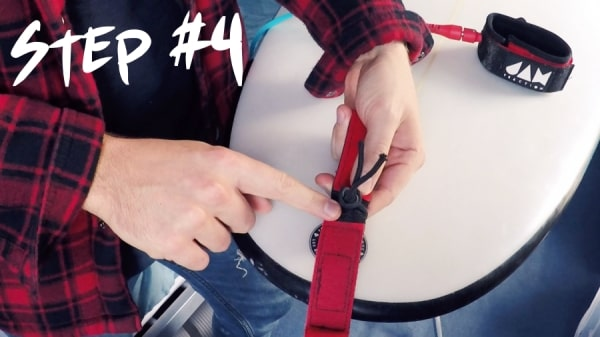 How-to-attach-a-surfboard-leash-step-4-thewaveshack.com-min